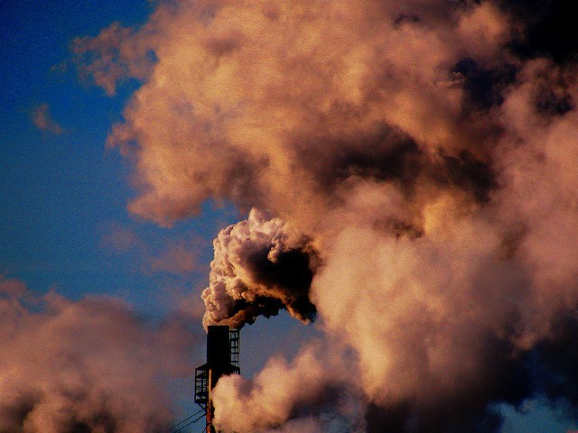 Pollution rising from a smokestack