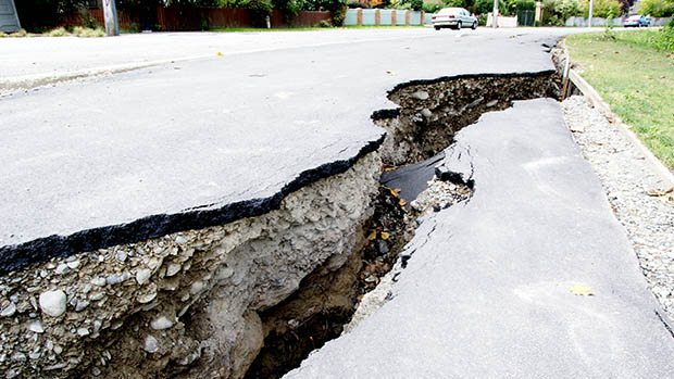Photo of ground displacement (massive crack in a road) after an earthquake