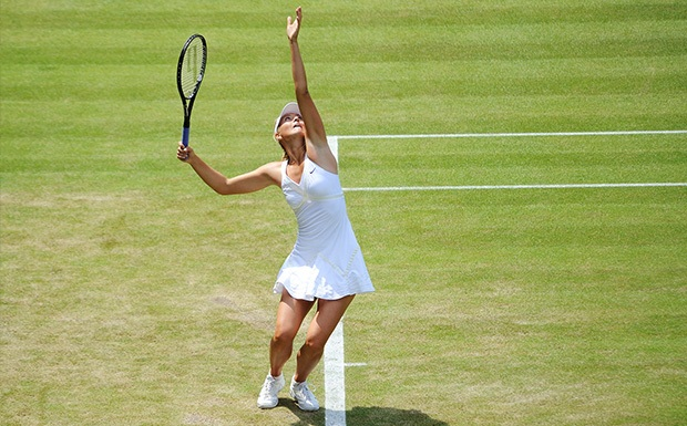 Maria Sharapova serving a tennis ball