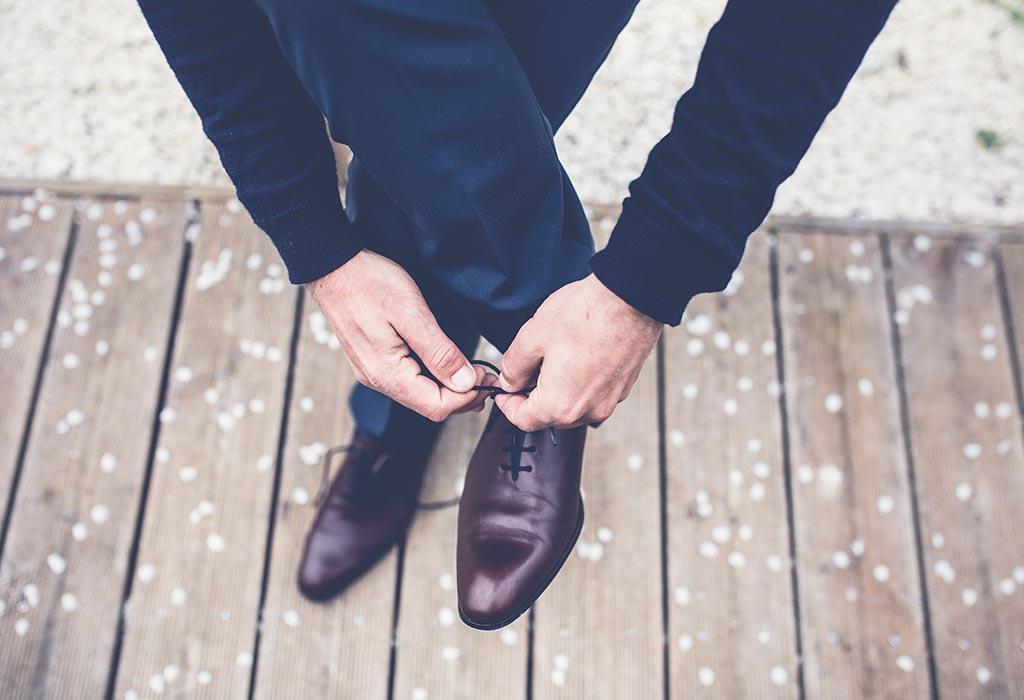 Close up of someone tying shoelaces
