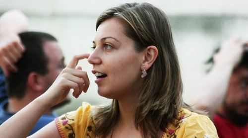 A woman scratching her nose