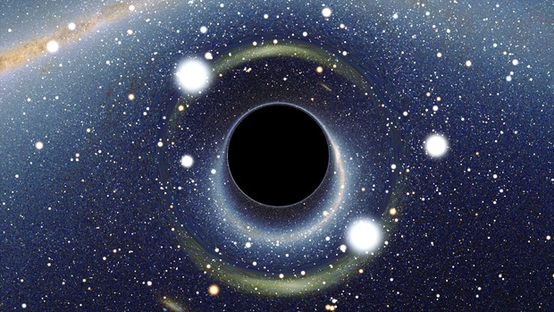 A simulated view of a black hole. It is a round, dark object, and it distorts the light that travels nearby it, making it appear to 'warp' the space around it.