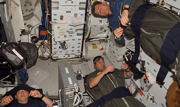 Astronauts in their sleeping bags.