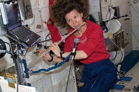 Astronaut Cady Coleman playing a flute on board the International Space Station.