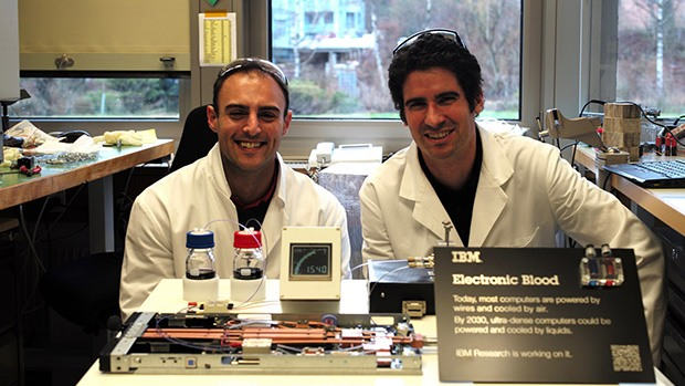 IBM research scientists with a redox flow battery.