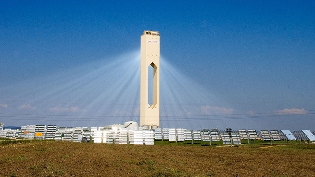 Many mirrors reflecting light onto the solar tower at the PS10 facility in Spain