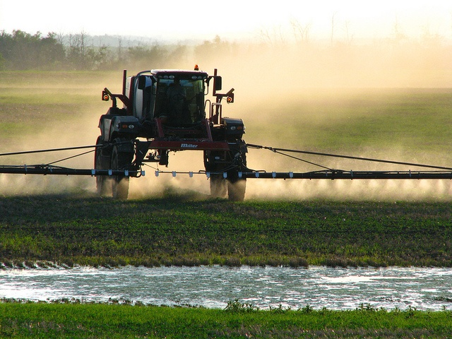 A truck spraying herbicides in a field.