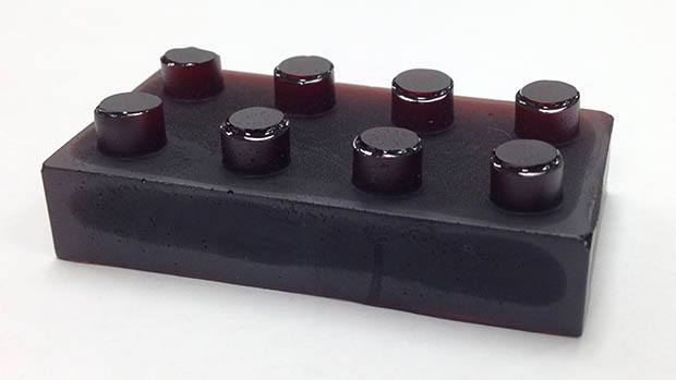 a moulded block of the mercury bonding polymer in the shape of a lego brick
