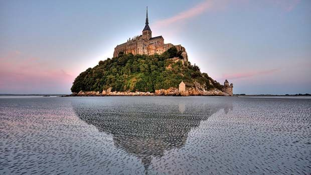 A photograph of Mont. St. Michele during a high tide, when the island is completely cut off from the mainland.