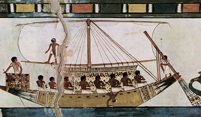 An ancient tablet showing an Egyptian riverboat with a sail