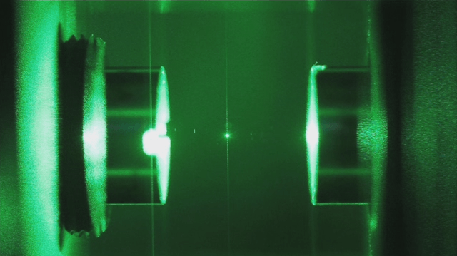 Glass nanoparticle suspended in optical cavity