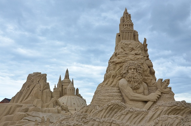 Intricate sand sculptures on a beach