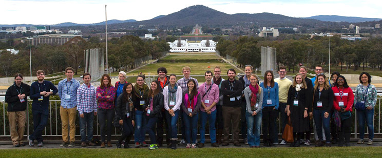 photo of group of participants on roof of parliament house overlooking Canberra