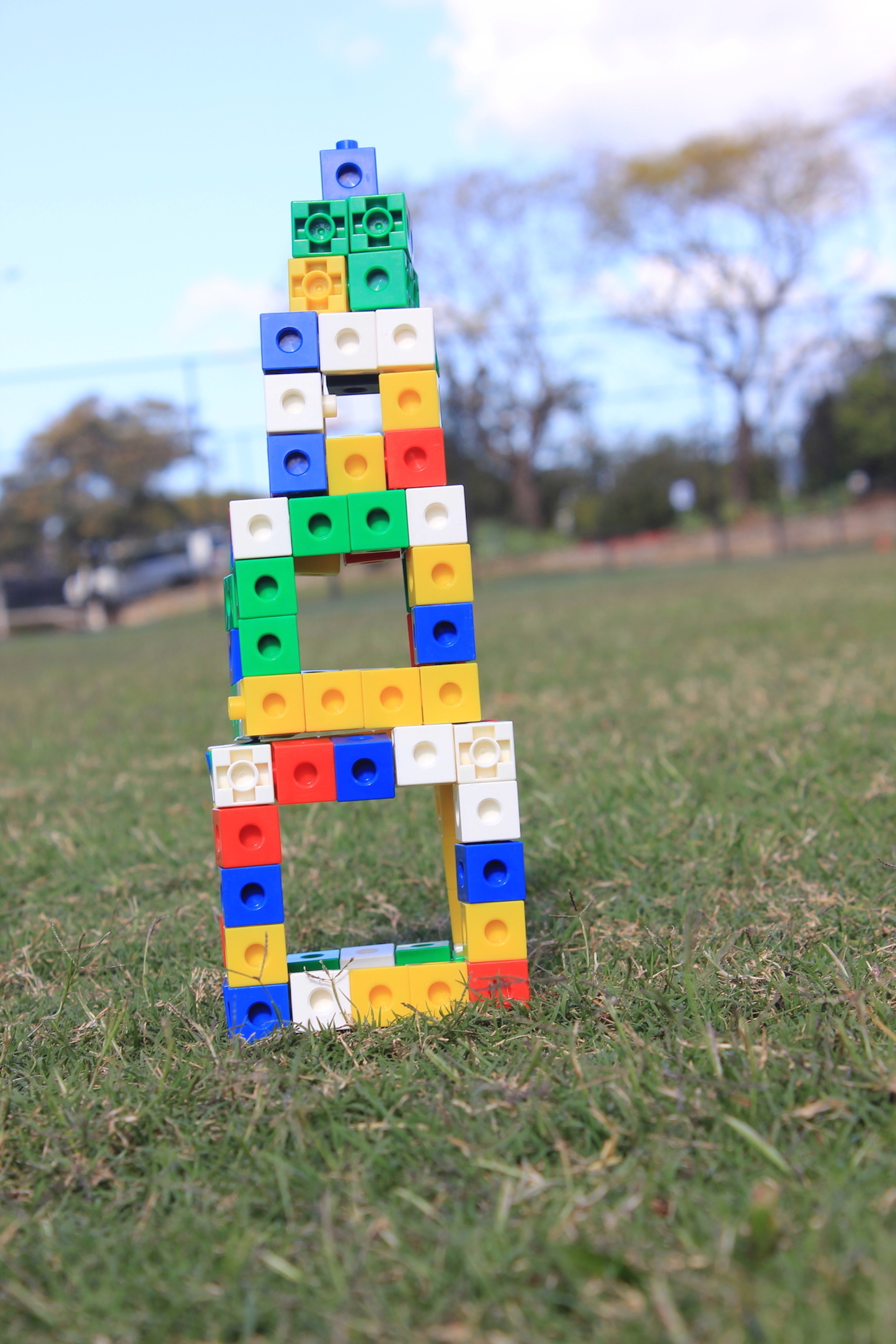 Name: Tang and Sarethaveekul. Prize: Shortlist. It is the tower that is made with blocks. It is from largest to smallest. Its start by 5x5 and getting smaller by 1 dimension each time until it gets into 1x1.  These can shows the areas and perimeter.